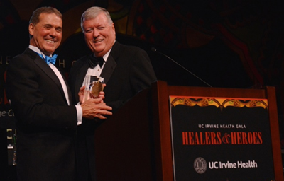 At the fundraising event, Terry A. Belmont (left), UC Irvine Medical Center CEO, honored Michael K. Hayde, Western National Group CEO, for his transformational impact on patient care.